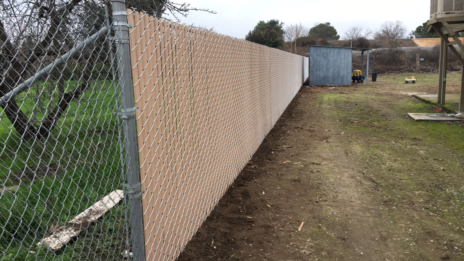 Privacy chain link fencing anderson fence co for Chain link privacy panels